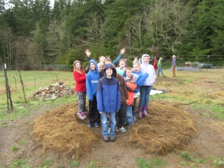 Proud students creating more fertile soil!