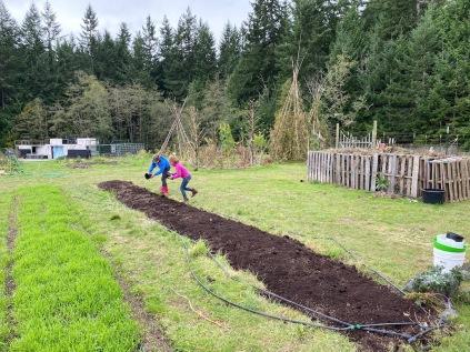 More compost spreading - fun!